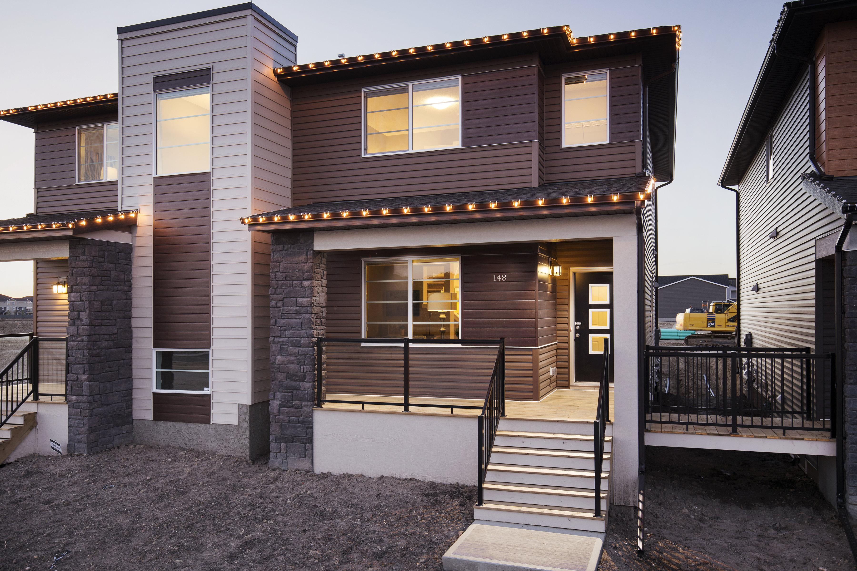 exterior of a shane homes duplex showhome with deck to next door.