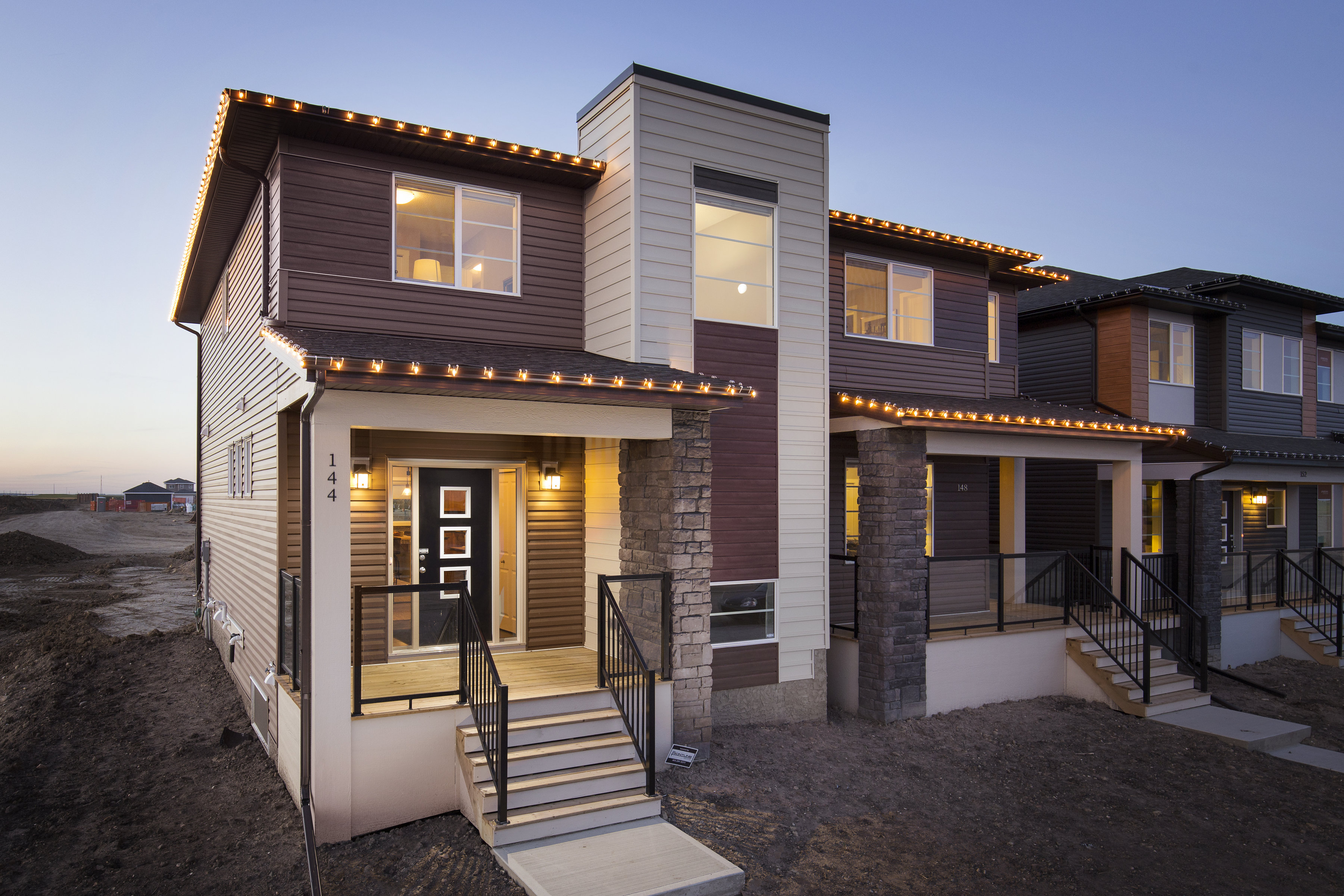 exterior view of the shane homes duplex home from the street at cornerstone community.