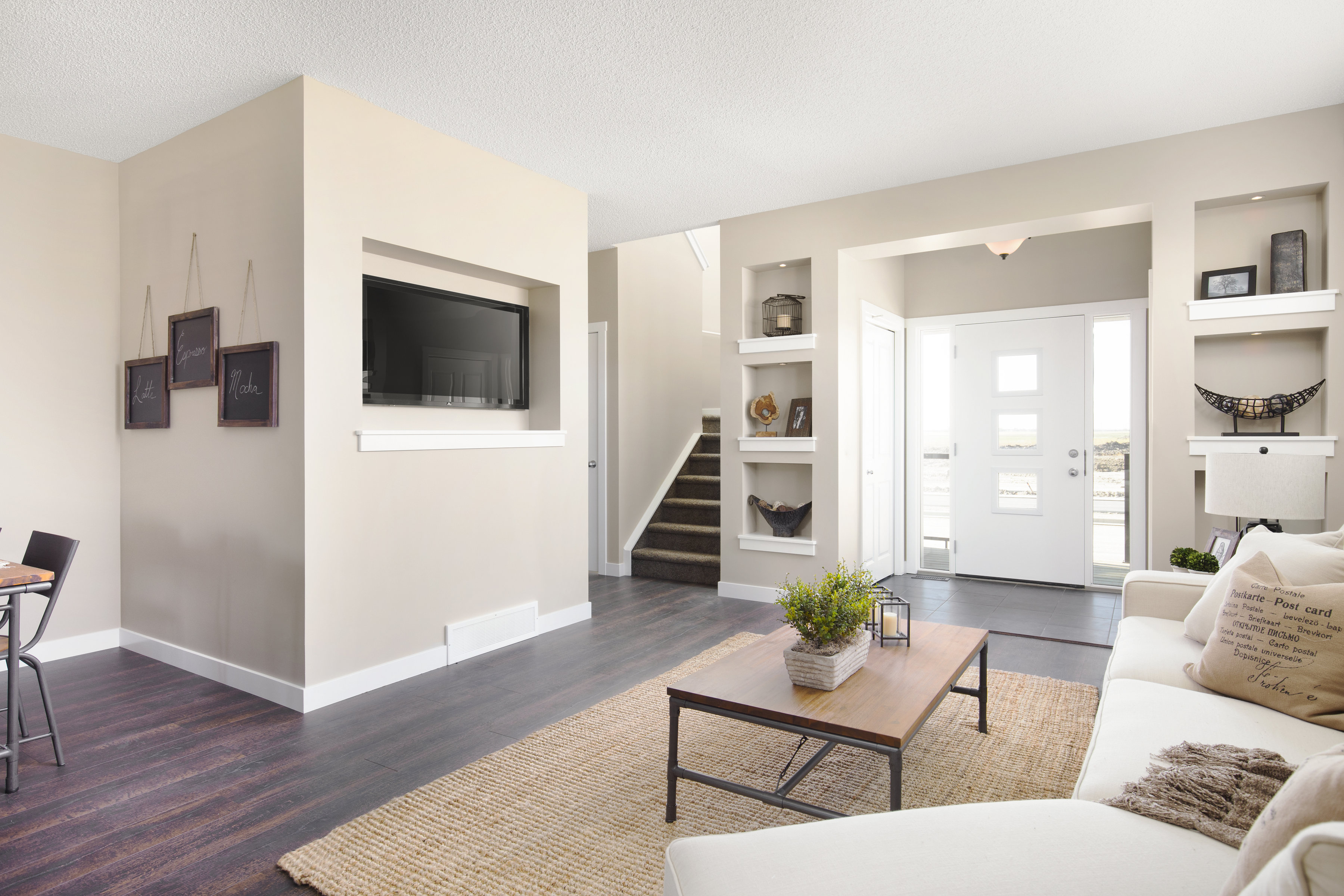 the front entrance and living room of a shane homes duplex home.