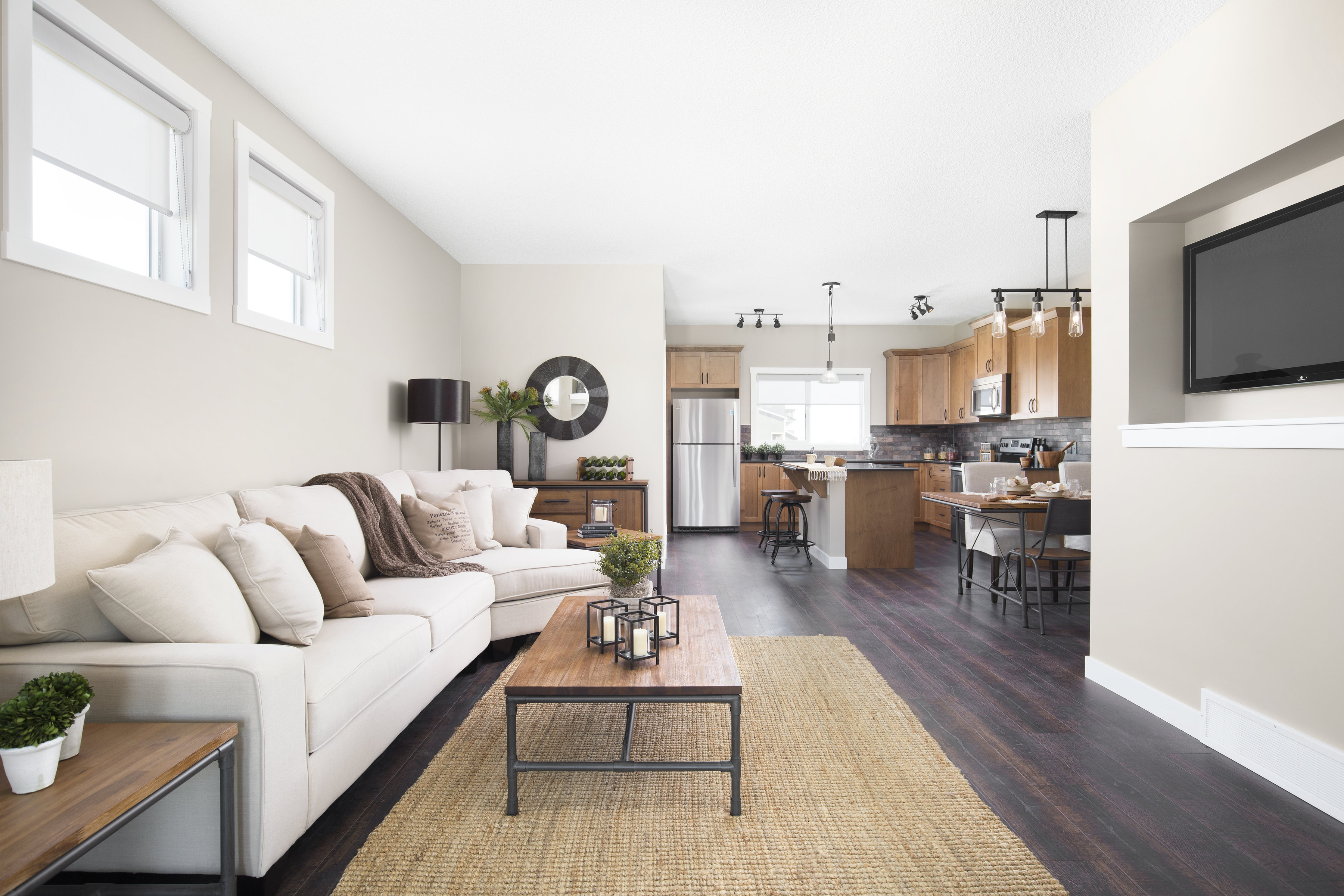 view of open concept living room, dining room, kitchen in a shane homes duplex showhome.