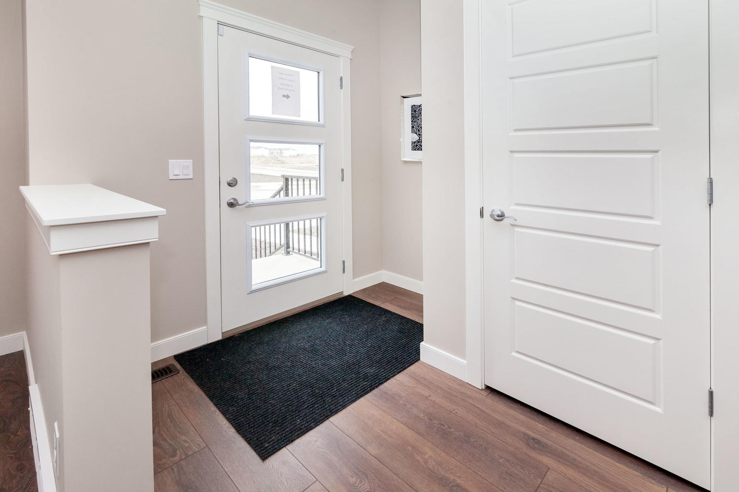 front entrance with shoe closet in the pacesetter zero lot line home