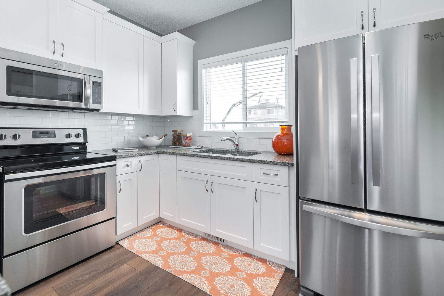 kitchen with stainless steel appliances in the pacesetter zero lot line home