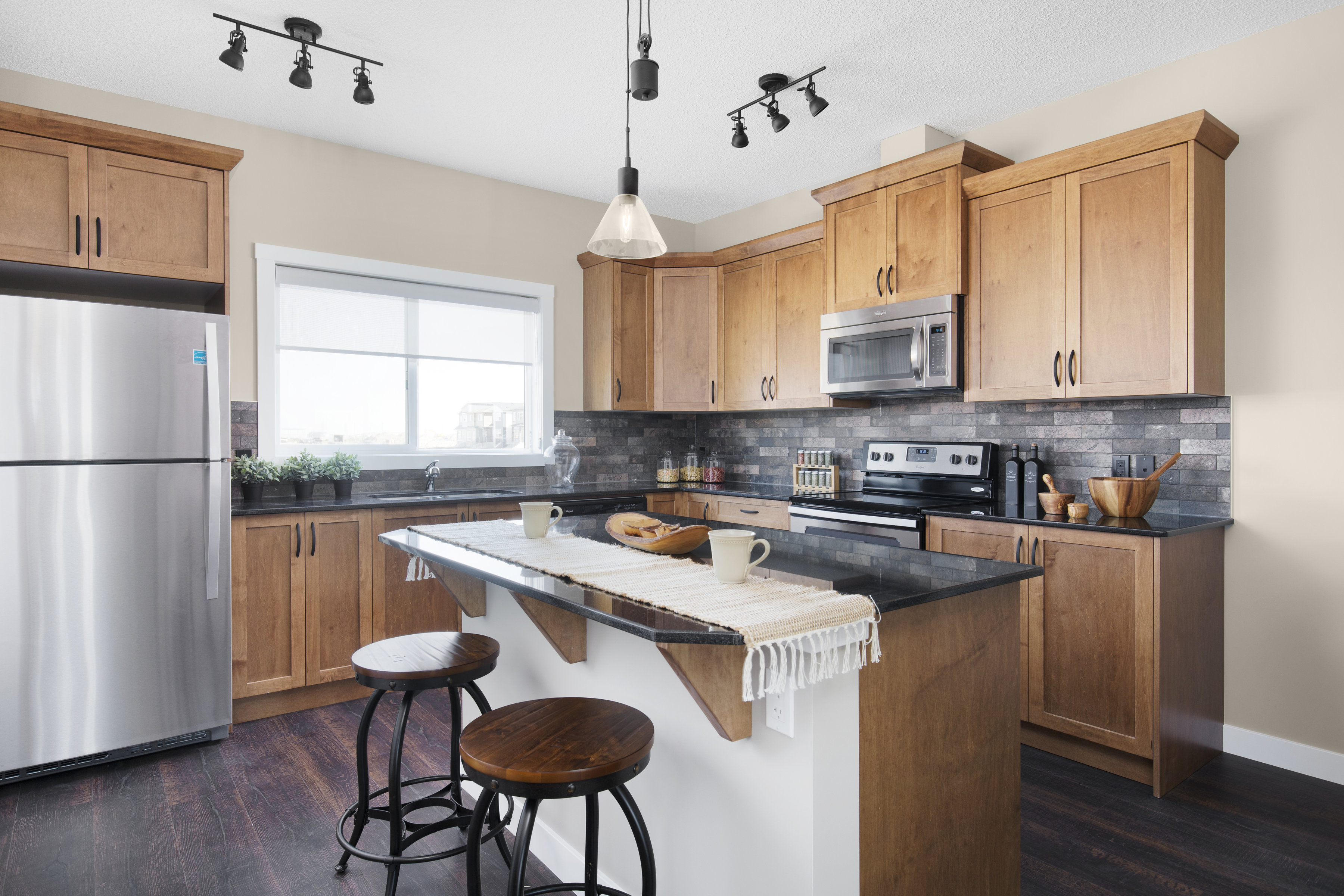 the kitchen with island in the shane homes duplex showhome.
