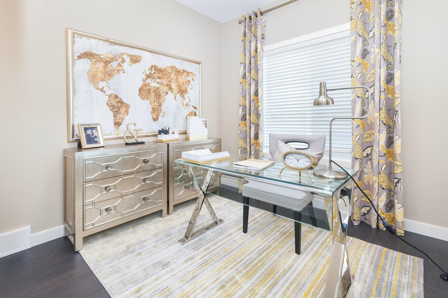 office with glass desk in the pacesetter front drive show home.