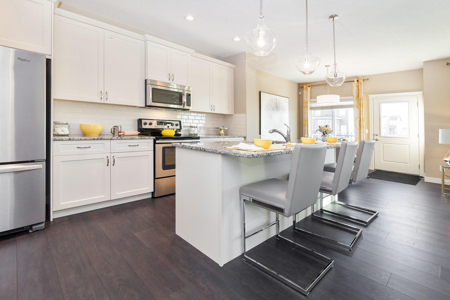 open concept kitchen with side entrance in a pacesetter front drive show home.