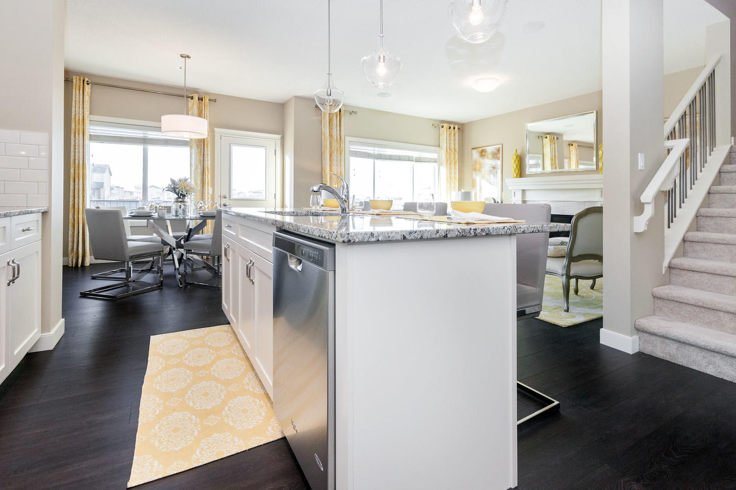 kitchen island in open concept kitchen, dining room, and living room pacesetter front drive home.