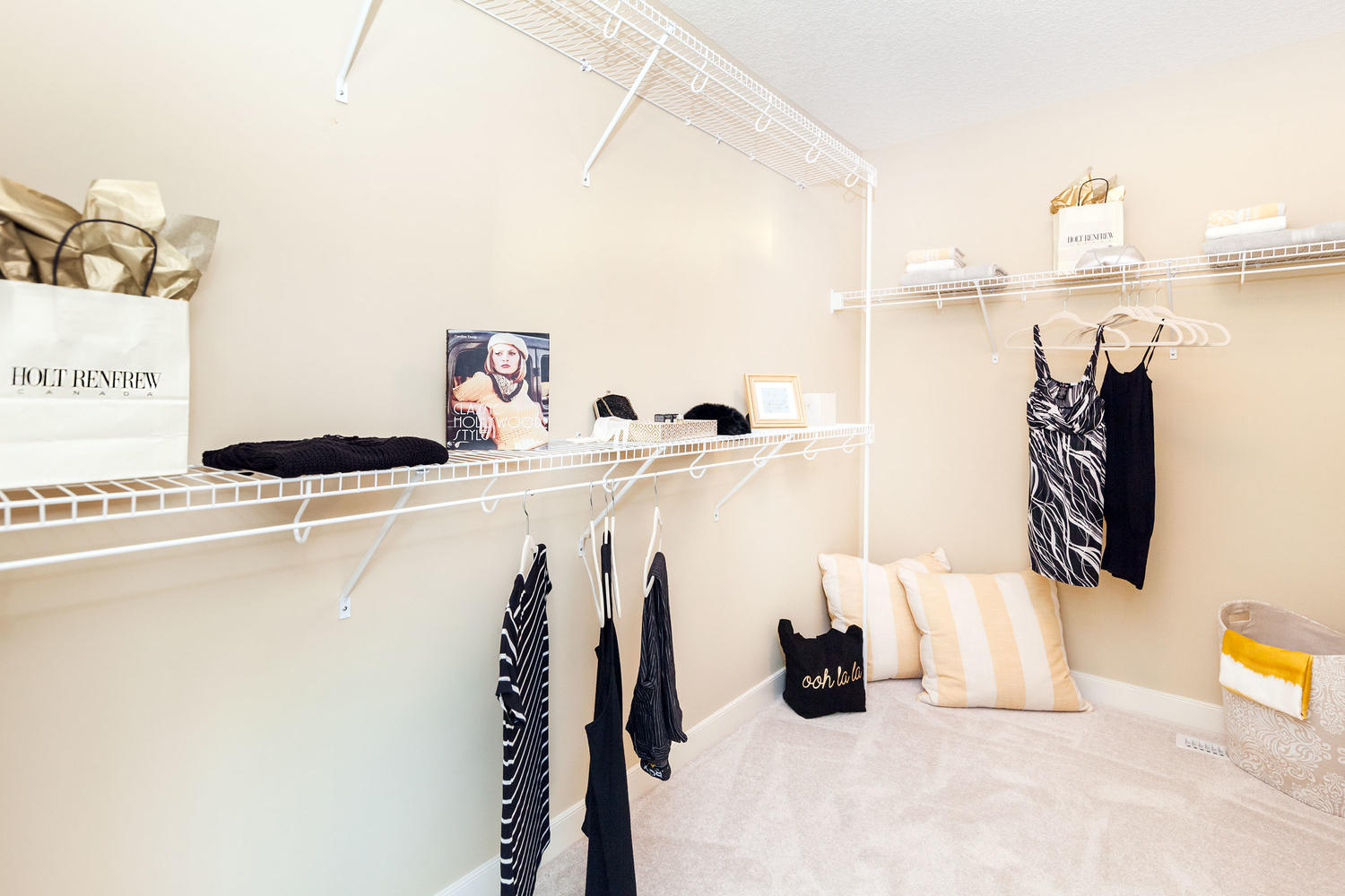 walk in closet in main bedroom of a pacesetter front drive show home.