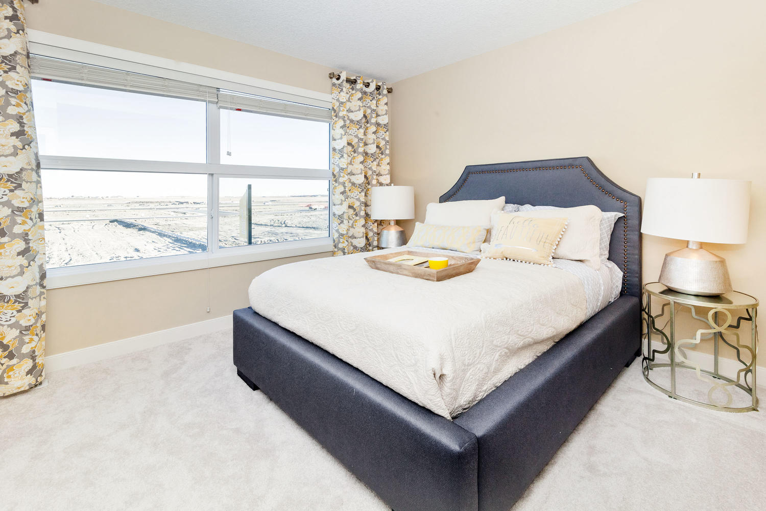 faux leather headboard in bedroom of the pacesetter front drive show home.