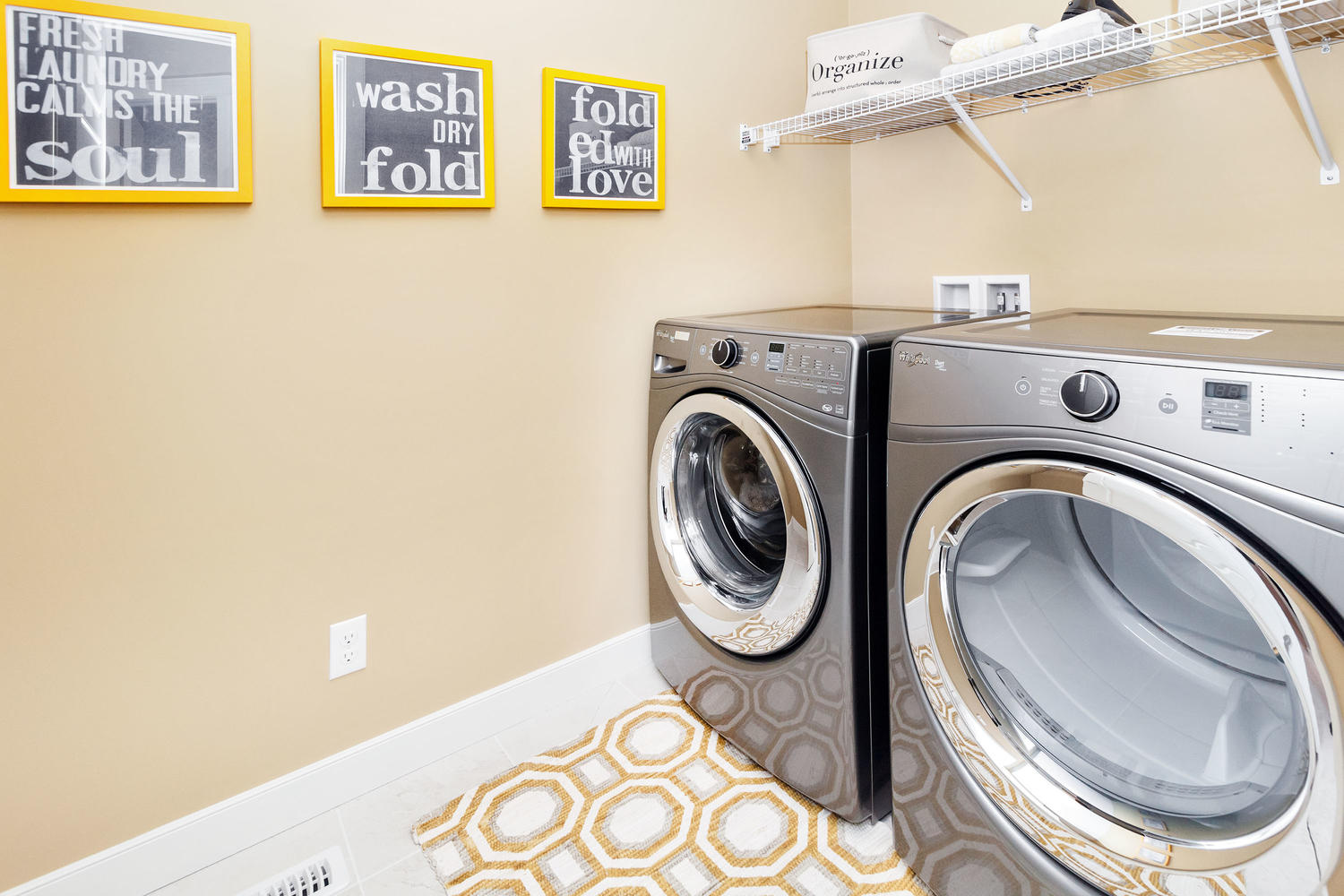 pastel yellow wall feature in the laundry room of a pacesetter front drive home.