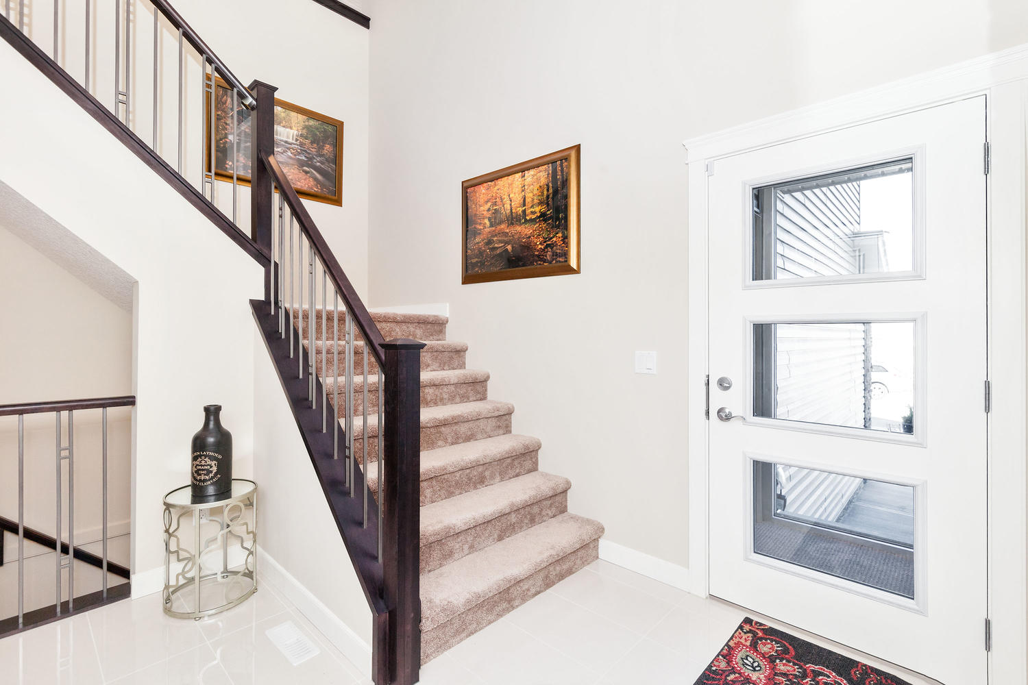 the glass paneled front entrance door and staircase a pacesetter front drive home.