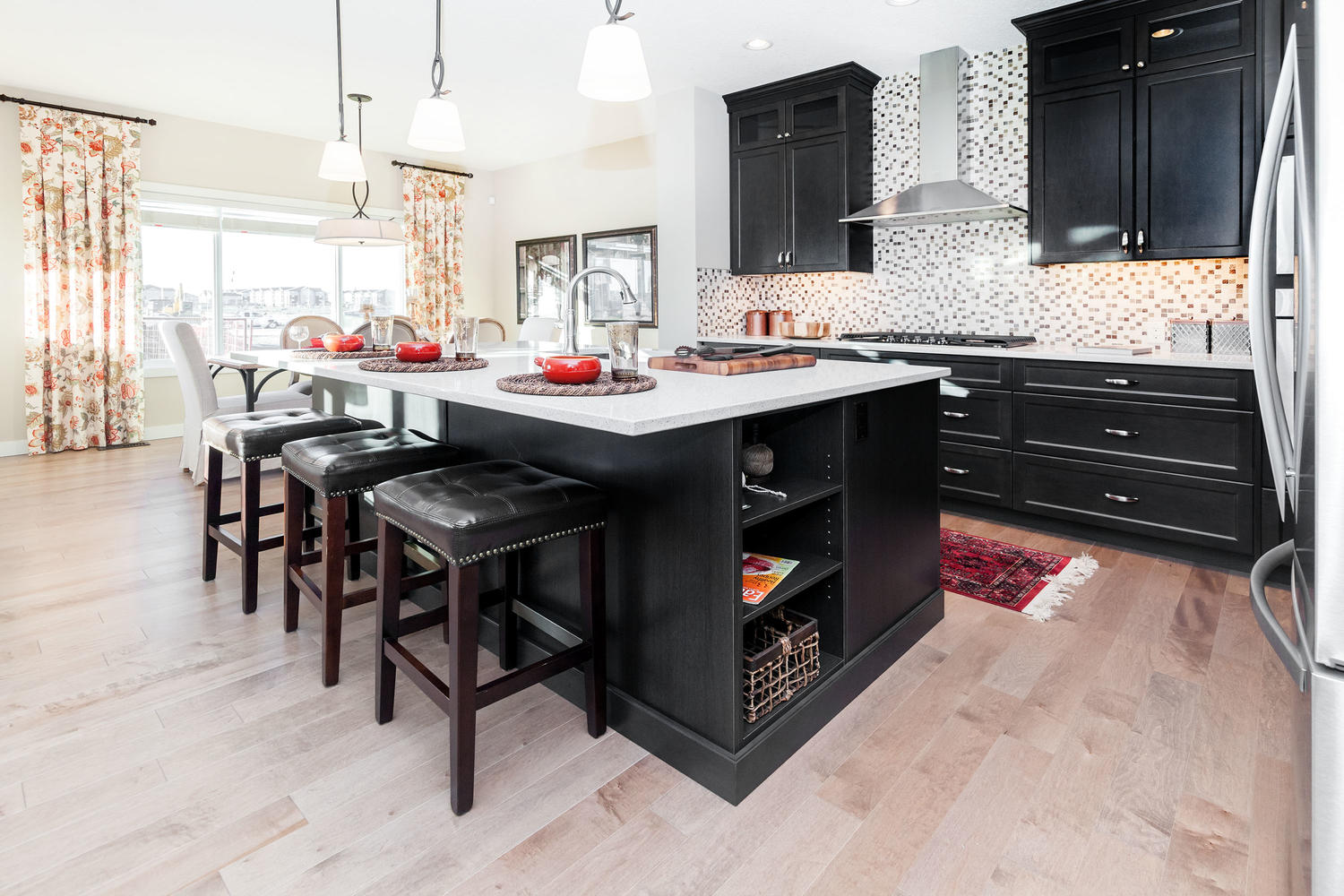 the open concept kitchen and dining room in the pacesetter front drive home.