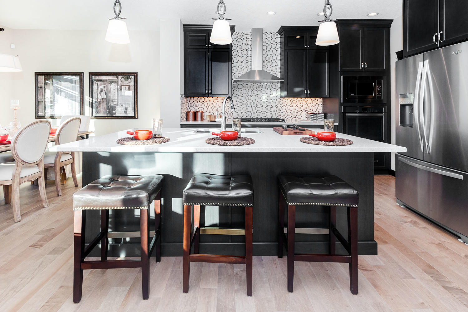 large kitchen island option in the kitchen of a pacesetter front drive home.