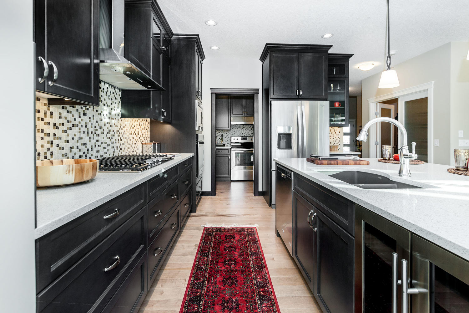 the kitchen with island and an additional butler's pantry in a pacesetter front drive home.