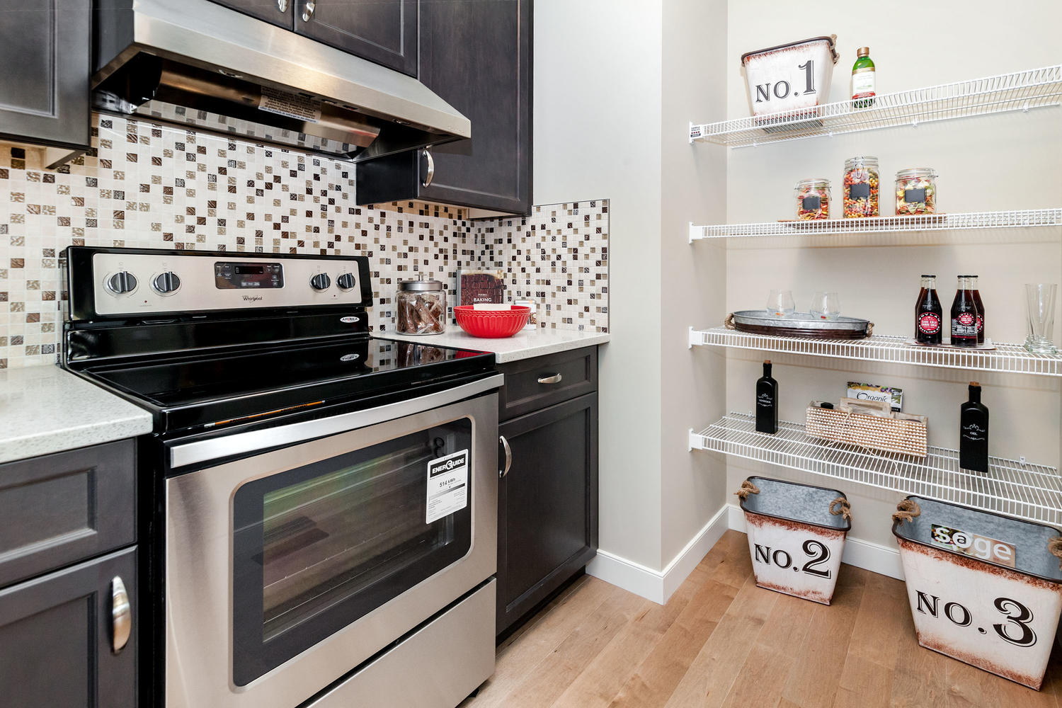 open concept pantry and stove in a pacesetter front drive home kitchen.