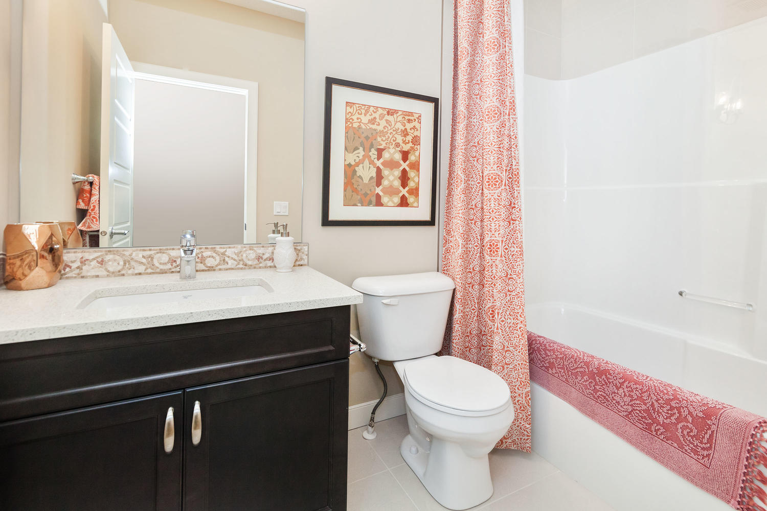 the upstairs bathroom with combination shower and tub in a pacesetter front drive home.