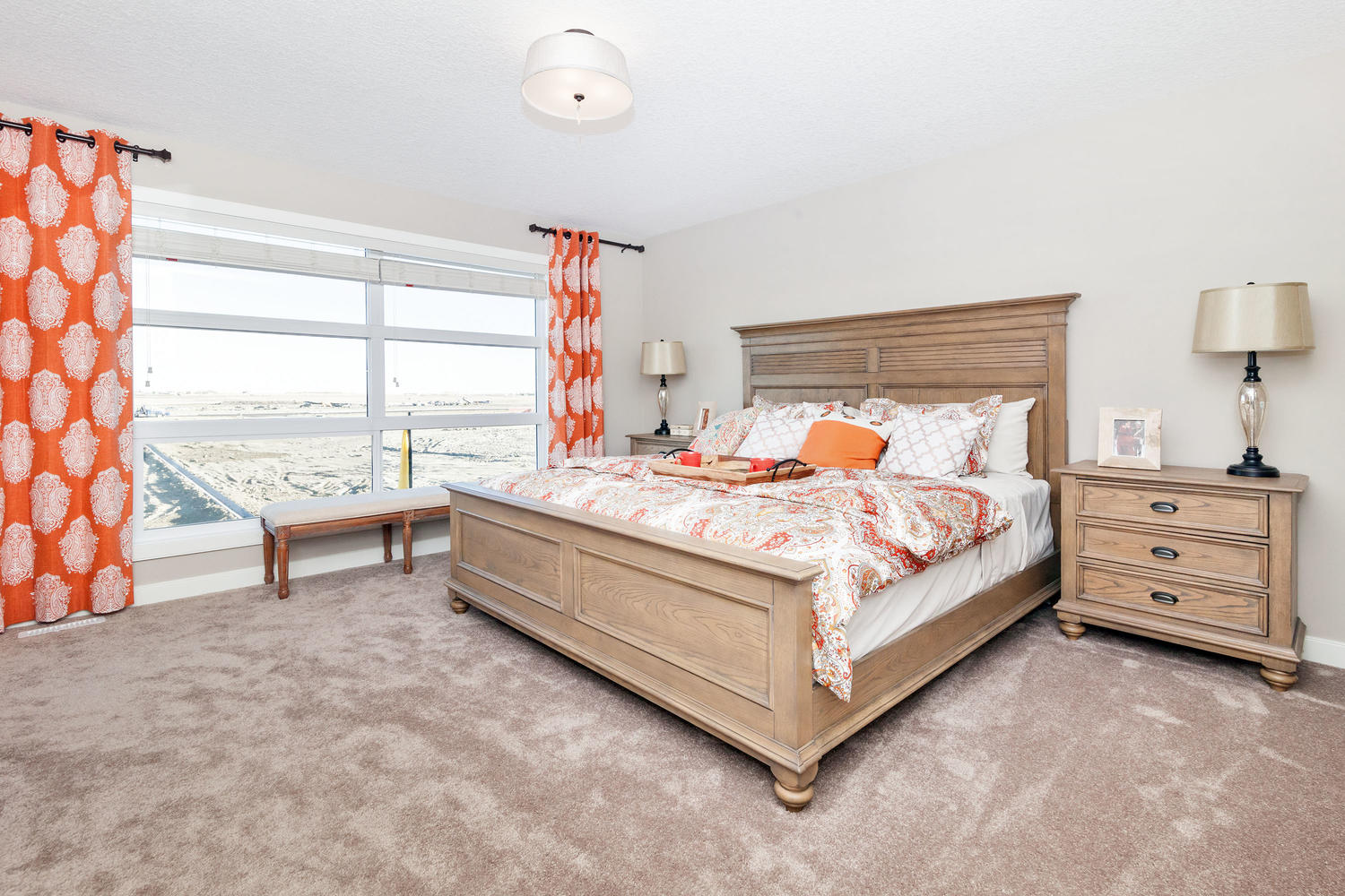 the master bedroom of a pacesetter front drive home.