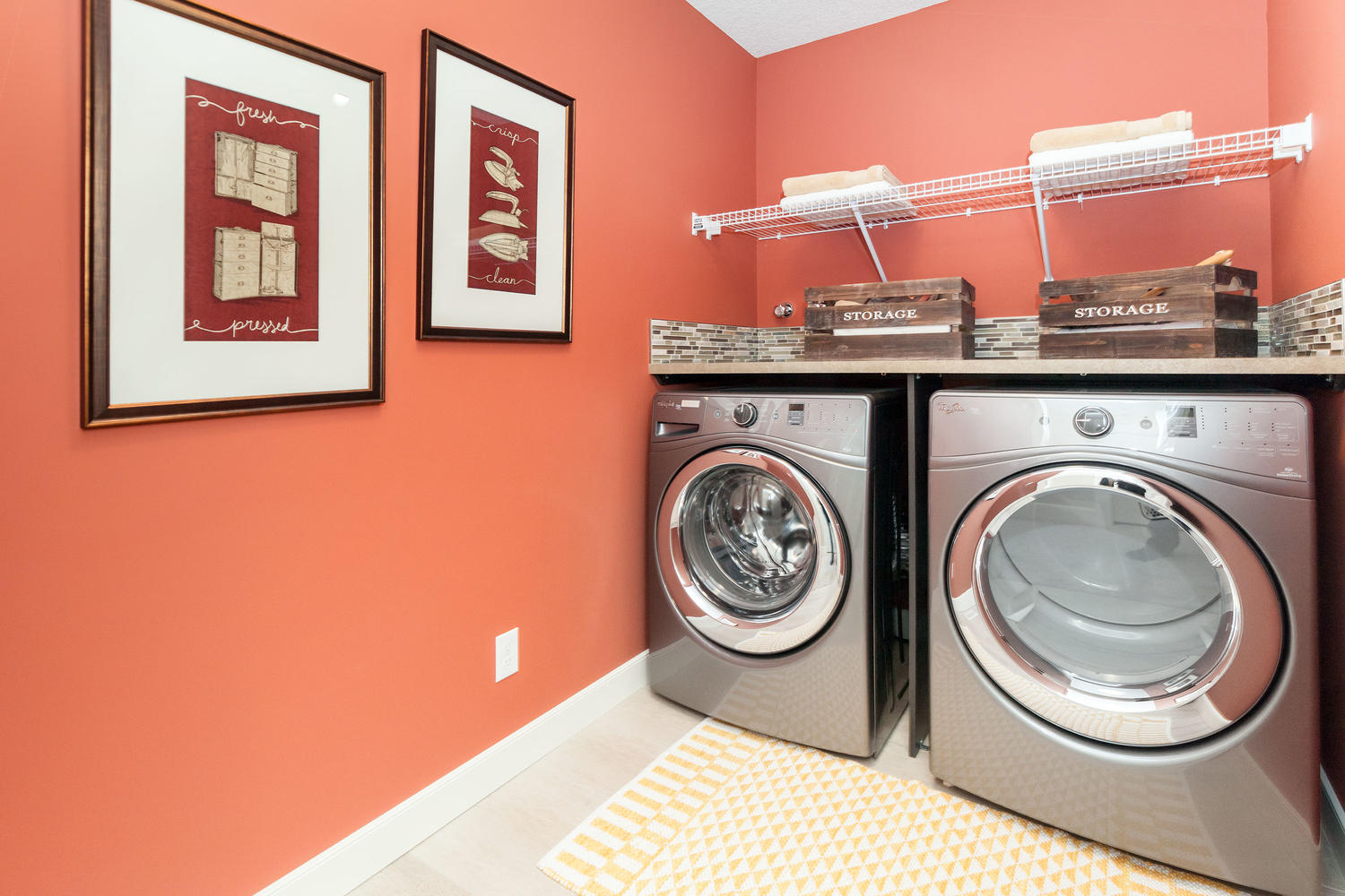 burnt orange painted wall in the laundry room of the pacesetter front drive homes.