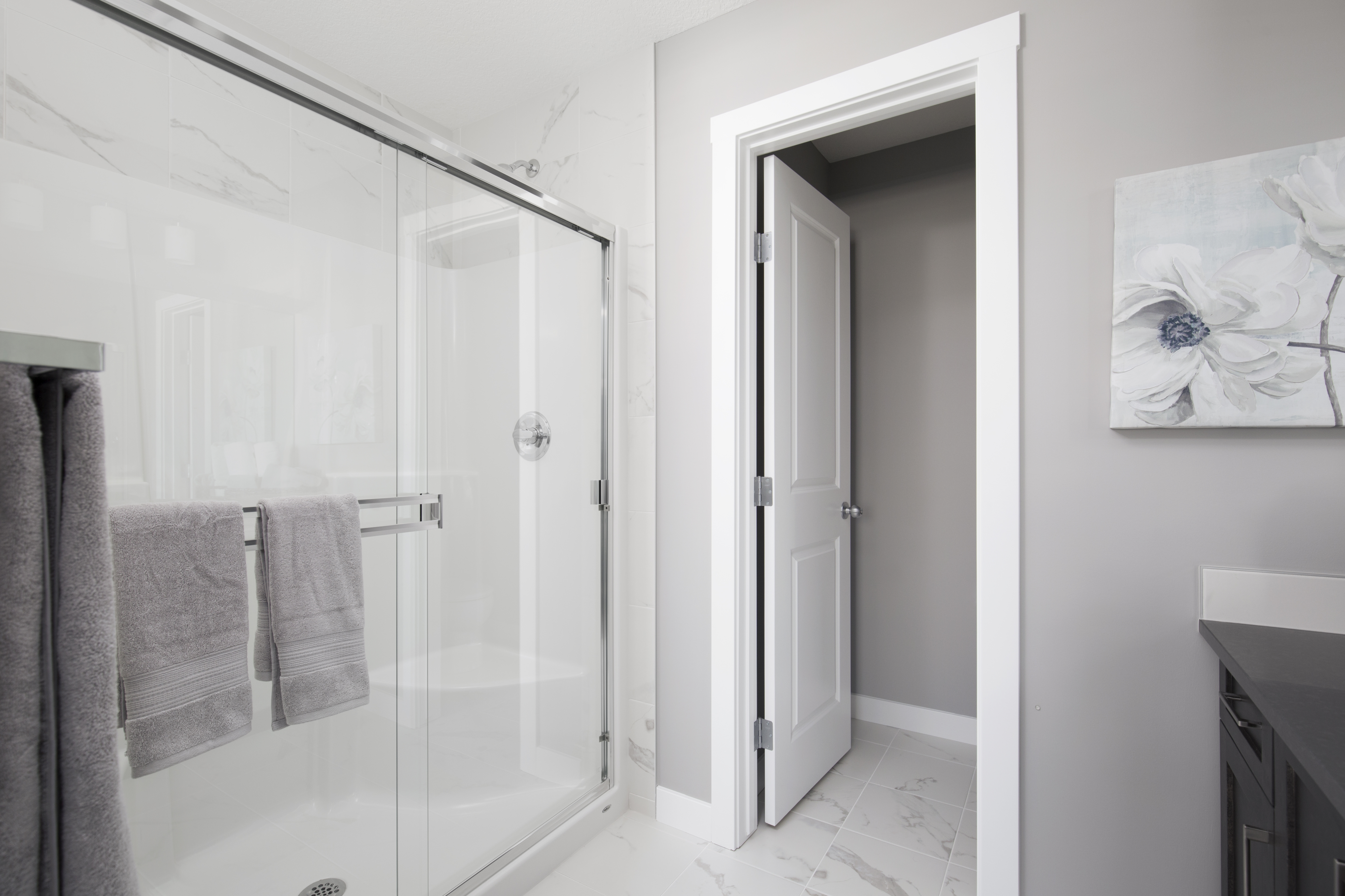extra large shower and powder room in the shane home street-oriented townhome.