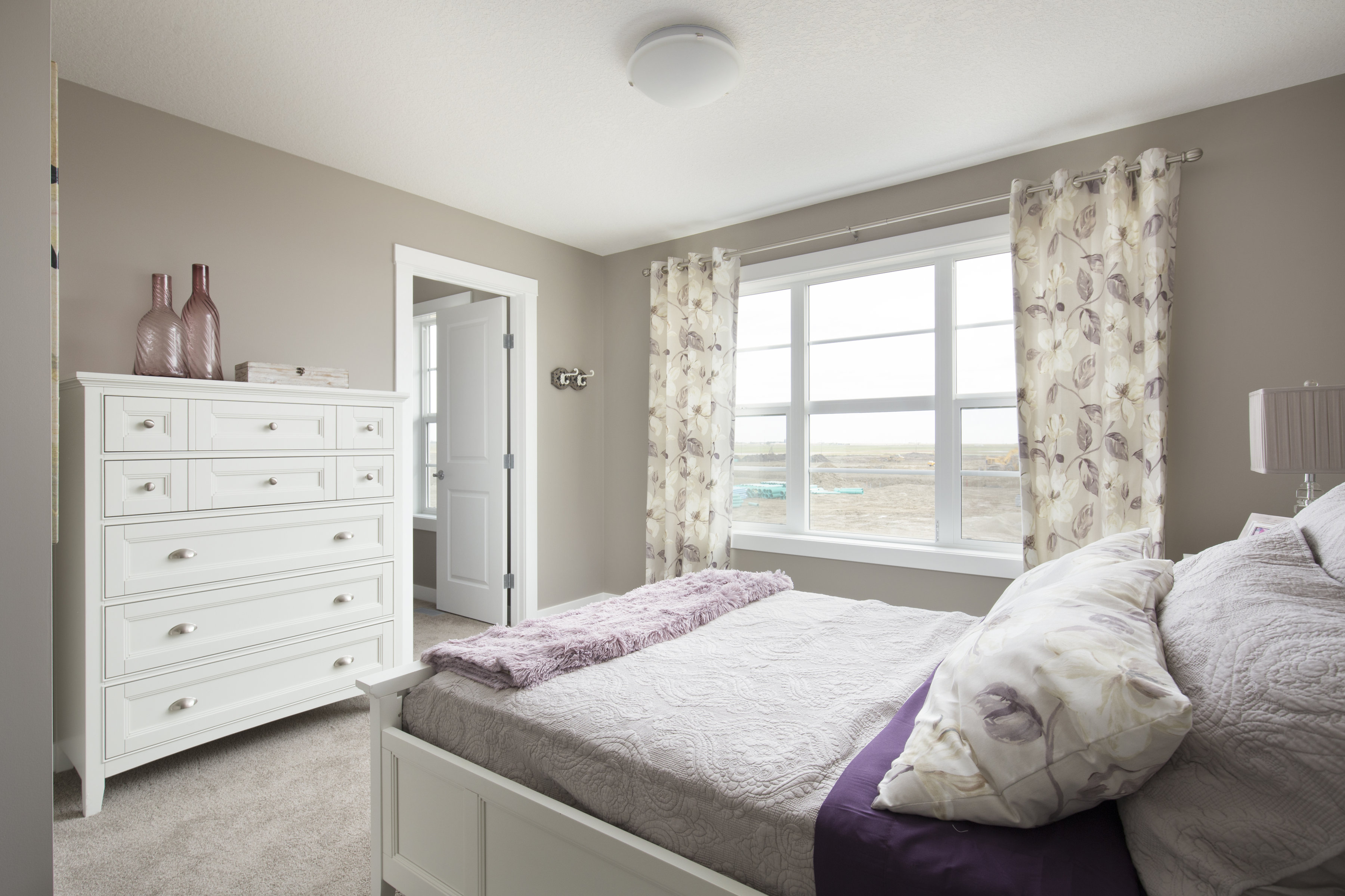 example of a bedroom in shane front drive homes at cornerstone community.