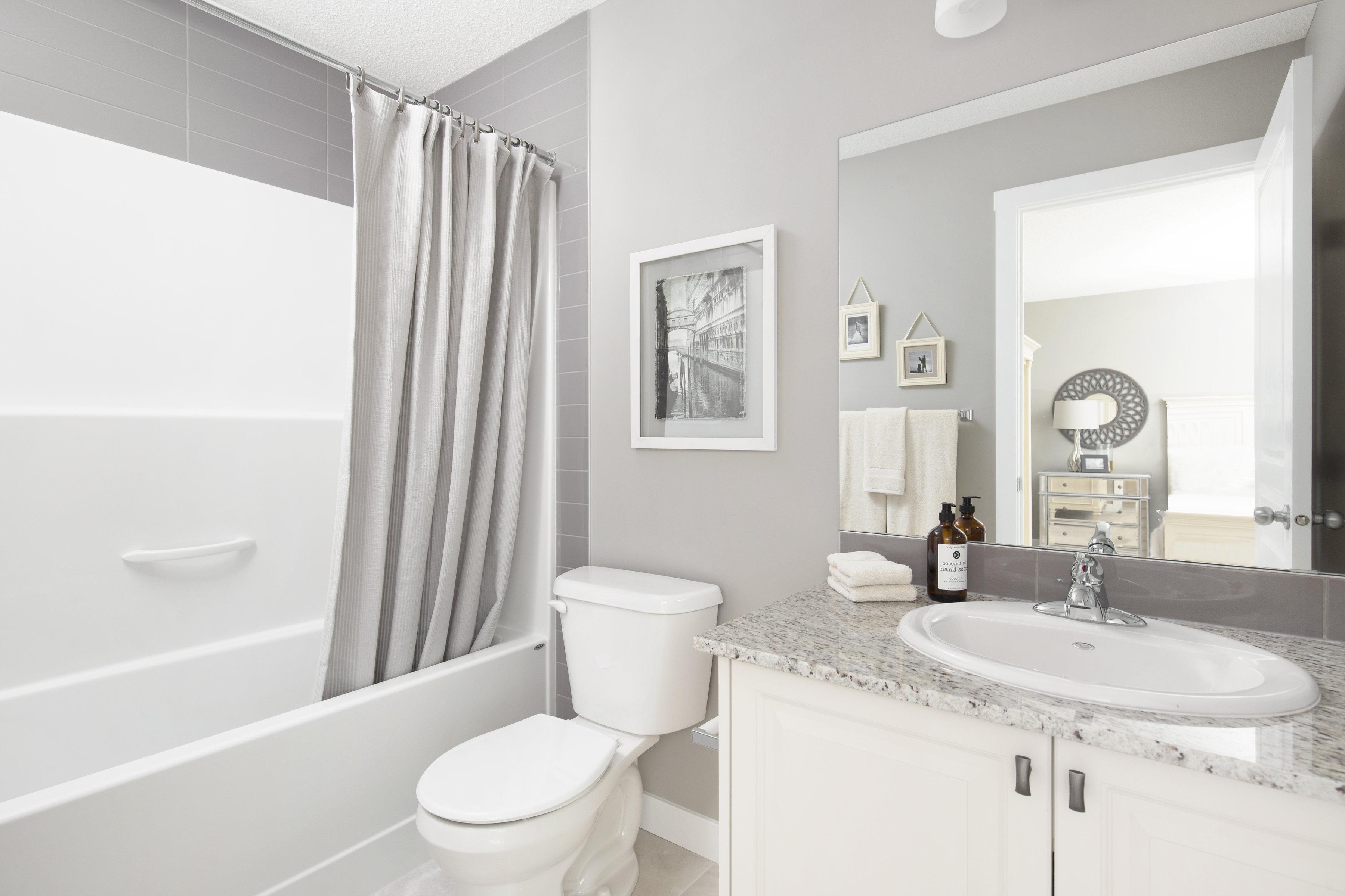 ensuite bathroom in a shane homes duplex showhome.