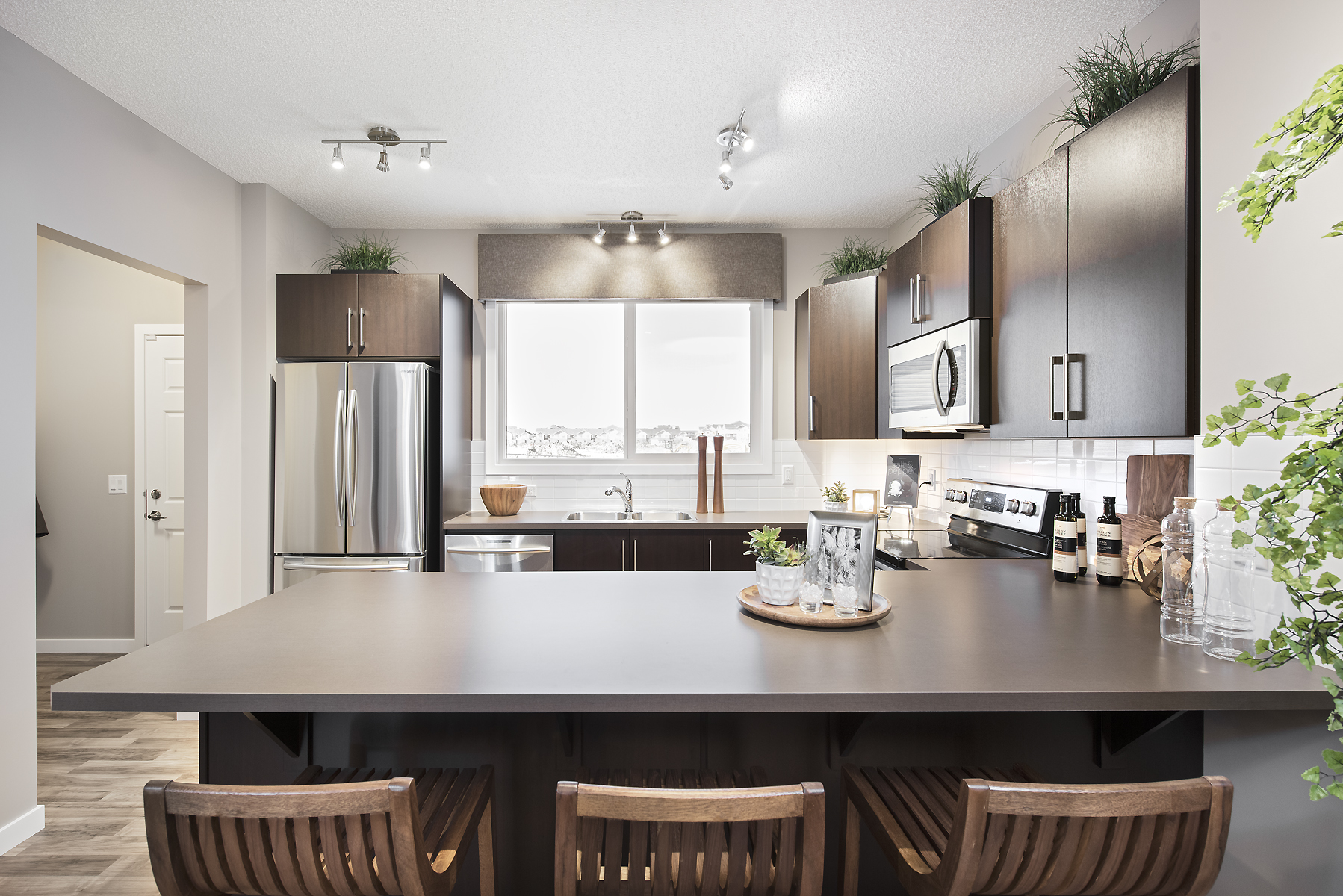the kitchen option with attached island in a jayman built zero-lot line home.