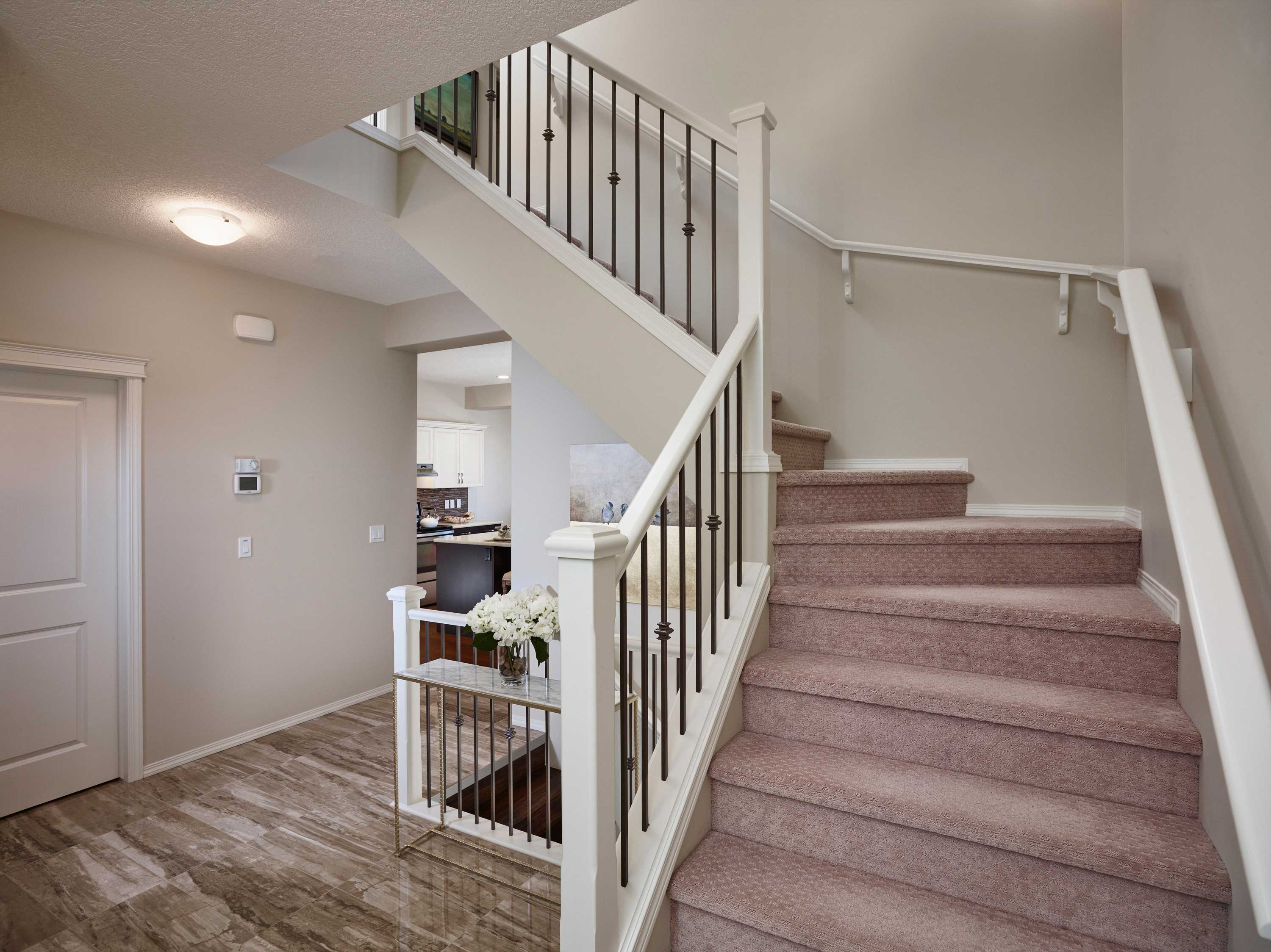 angled staircase in a morrison front drive show home.