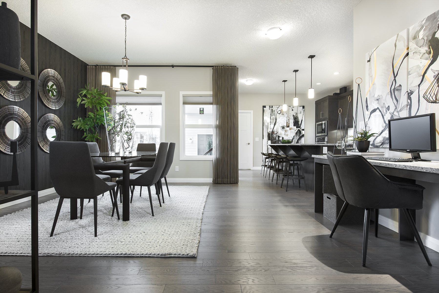 the combination dining room and kitchen in the carrara model courtyard home by jayman built.