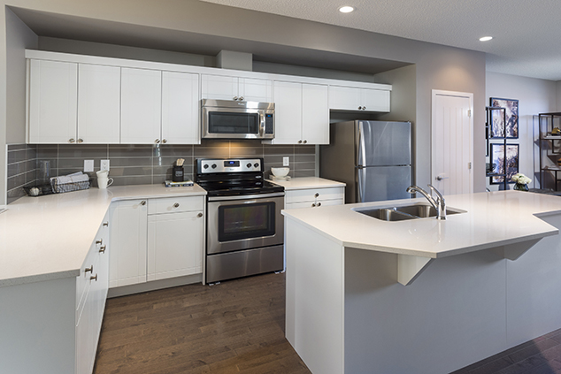 kitchen with large island of a morrison duplex home model carter.
