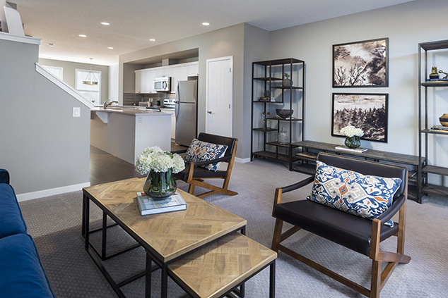 open concept kitchen and living room in the morrison duplex show home model carter.