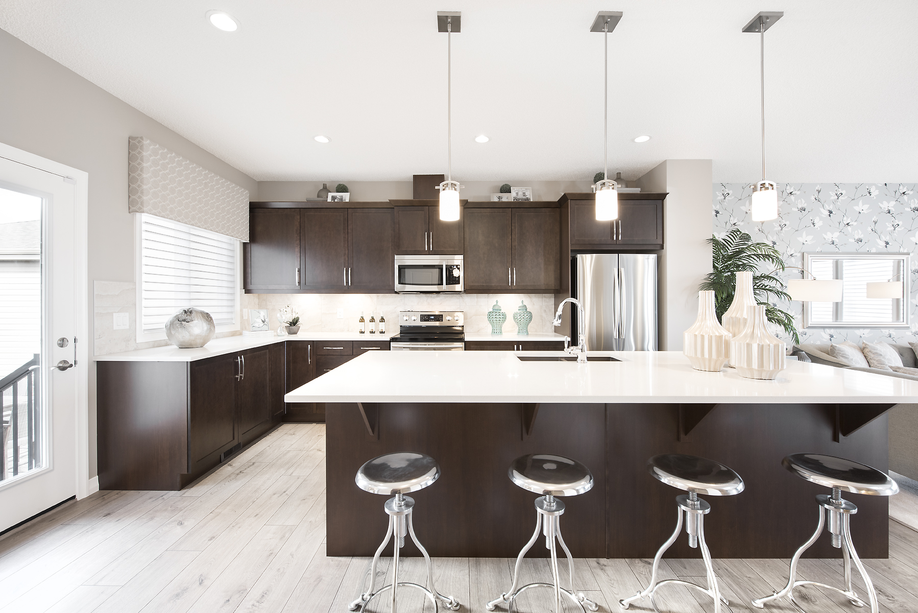 open concept kitchen with large island in the istoria model courtyard home by jayman built homes.