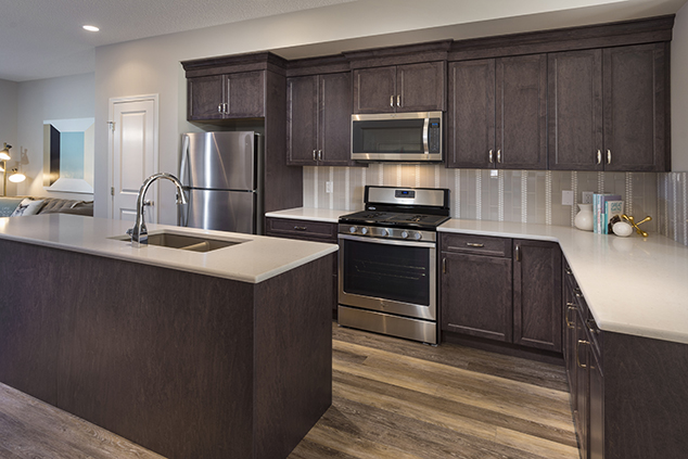 large kitchen with island and countertops in the morrison home duplex homes.