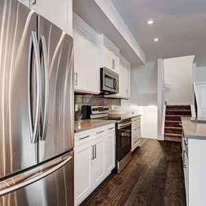 The kitchen in the Luxuria Townhome