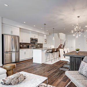 The Luxuria kitchen and living room area in the townhome house type