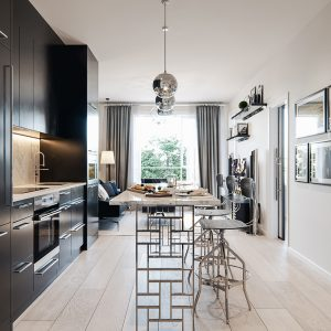 The open floor style kitchen and living room in the Legends Condominium