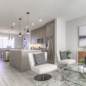The mixed use kitchen and living room area in the Truman Duplex Show Home