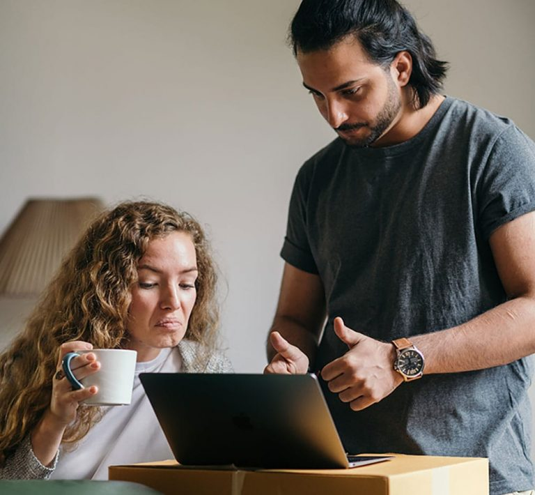 A young couple talk to their mortgage advisor on the laptop