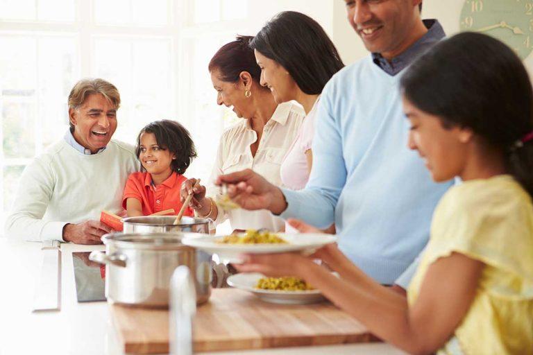 Multi Generational Family Eating Dinner